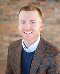 Agente de seguros Adam Peterson