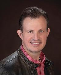 Agente de seguros Tim Lecher