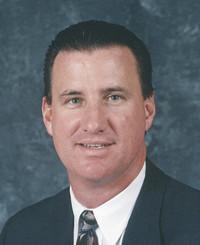 Agente de seguros Tom McInally