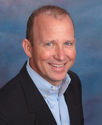 Insurance Agent Tom Kernan