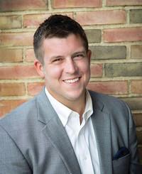 Agente de seguros Alex Ottney