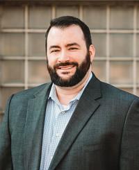 Agente de seguros Jason Adcock