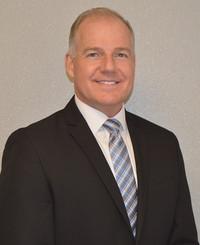 Agente de seguros Tim Wood