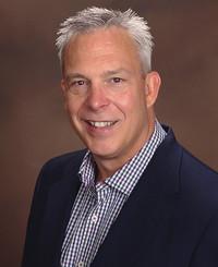 Agente de seguros John Sutton