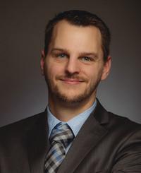 Agente de seguros Adam Crandall
