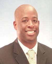Insurance Agent Gus Simeon