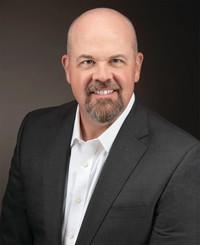 Agente de seguros Tim Maudsley