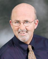 Agente de seguros Tim Long